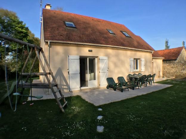 Maison avec 4 chambres et un garage