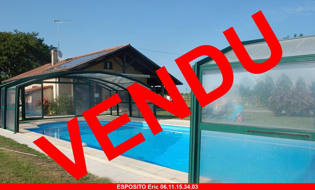 Maison T7 sur 5440 m² avec piscine couverte