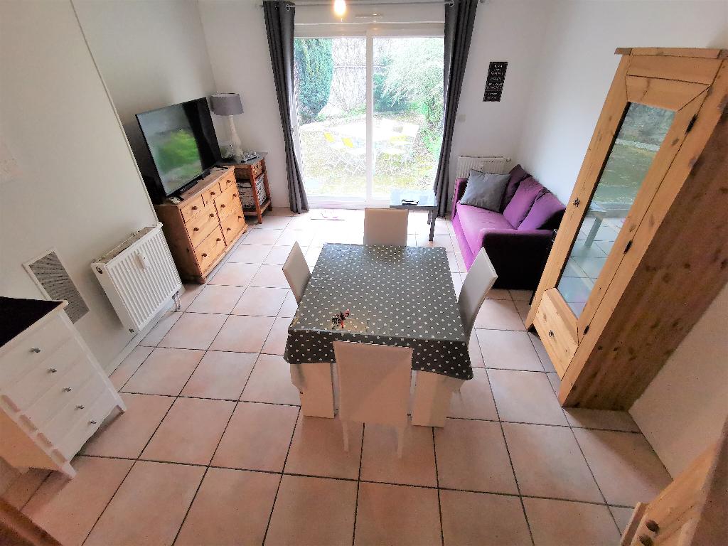 Appartement F3 avec jardin terrasse de 90M² + cave