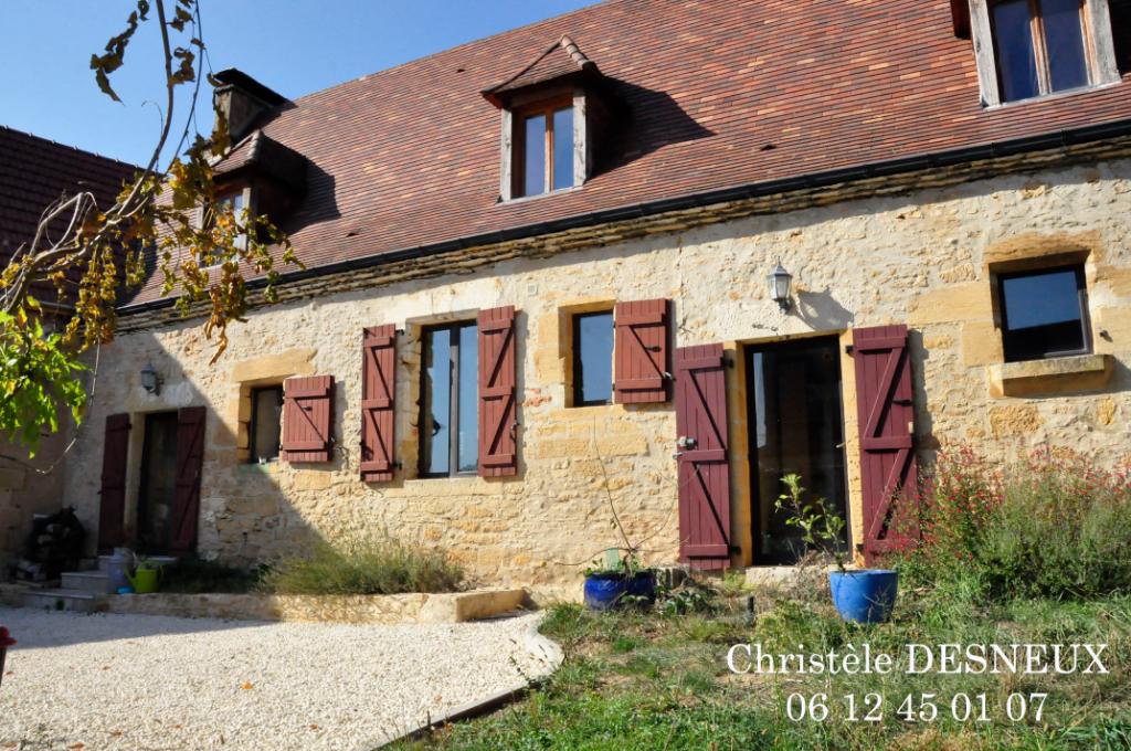 Maison en pierre av grange