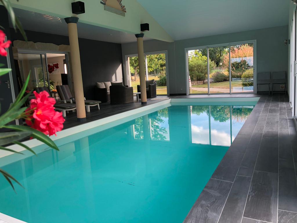 Maison plain-pied 5 pièce(s) 140 m2 avec piscine