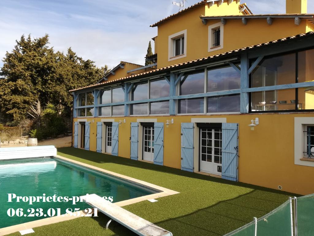 Maison T7 , 238 m2 habitables avec garage piscine et 2180m² de jardin