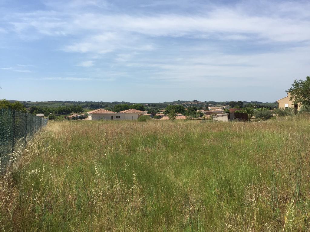 Magnifique terrain constructible de 1186 m2 - dominant avec vue