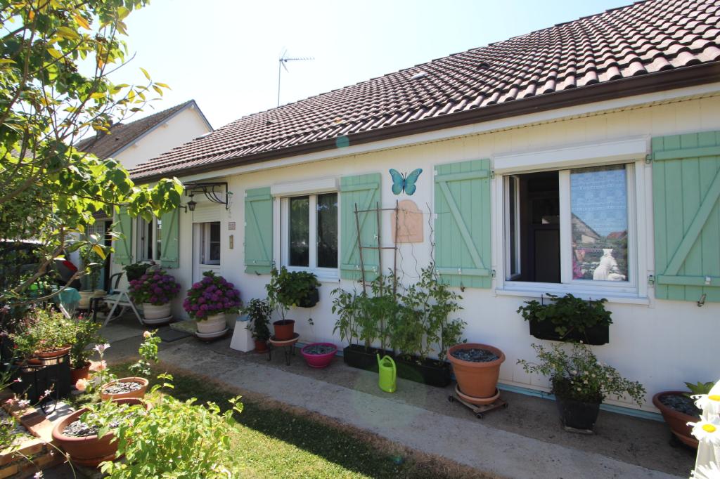 Maison de plain pied avec jardin proche des commodités